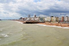 Brighton coast. It's a windy summer day in Brighton (The United Kingdom of Great Britain and Northern Ireland, England). It's a view from Brighton Pier at the royalty free stock images
