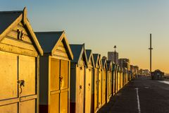 Brighton colorful beach hut beach house along the coast of Brighton Pier. Stock Photo