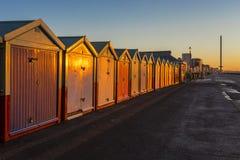 Brighton colorful beach hut beach house along the coast of Brighton Pier. Stock Images