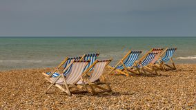Brighton, East Sussex, UK. Empty deck chairs at Brighton Beach, East Sussex, UK Stock Photography