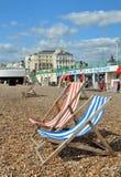 Brighton England - Deck chairs on Brighton Beach. Brighton, United Kingdom - April 16, 2012: Red & Blue striped Deck Chairs await the tourists on the beach Royalty Free Stock Image