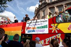 Brighton and Hove Bus company bus in Brighton Pride. People on a Brighton and Hove Bus Company bus in the Brighton Pride parade Royalty Free Stock Photo