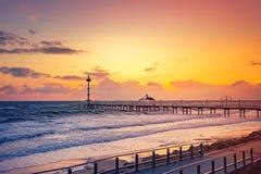 Brighton Jetty au coucher du soleil Image libre de droits
