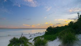 Sunset in Brighton Le Sand beach, Sydney. Brighton-Le-Sands is in the local government area of the Bayside Council and is part of the St George area. Lady stock photo