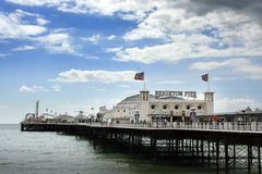 Brighton Palace Pier, England. Brighton Palace Pier with flags flying on windy day, England Stock Image