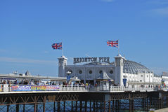 Brighton Palace Pier, England. Brighton Palace Pier with flags flying on windy day, England Stock Images