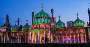 The Brighton pavilion floodlit at night. View of the Brighton royal pavilion floodlit at night stock photos