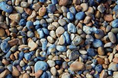 Brighton pebbles background, London UK. A colorful Brighton pebbles background from London UK beach stock image
