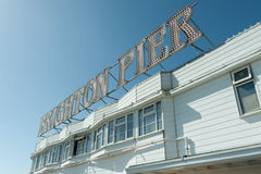 Brighton pier. Sign on Brighton Pier, one of the top seaside tourist attractions in the UK royalty free stock photo