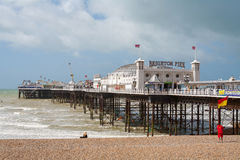 Brighton Pier. Brighton, England. BRIGHTON, EAST SUSSEX, ENGLAND - JUNE 15, 2013: View of Brighton pier and pebble beach Stock Photos