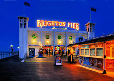 Brighton Pier, England. The famous Brighton Pier in England by night stock image