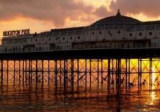 Brighton Pier, England. Sun setting under Brighton Pier suring winter Stock Photos