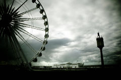 Brighton. Pier framed by wheel and old light Royalty Free Stock Photo