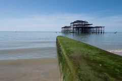 Brighton pier. With green breakwater Royalty Free Stock Image