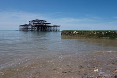 Brighton pier. With green stone breakwater Stock Photography