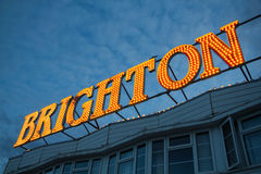 Brighton Pier Lights, England UK. Evening shot of a sign on Brighton Pier lit up by lightbulbs royalty free stock image