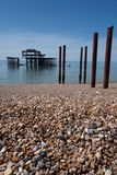 Brighton pier. With pebbles and poles Royalty Free Stock Photos