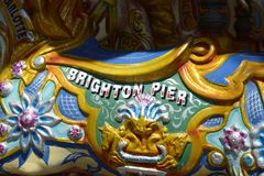 Brighton Pier sign on fairground roundabout. England Stock Photos