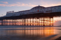 Brighton pier at sunset, warm red and orange colors Royalty Free Stock Image