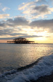 Brighton pier sunset waves Royalty Free Stock Photography