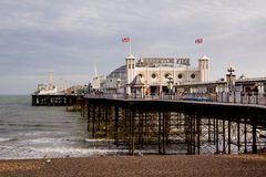 Brighton Pier taken from Brighton Beach. Landscape shot of Brighton Pier, also know as the Palace Pier royalty free stock image