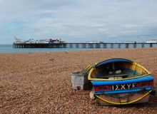 Brighton Pier, view from the beach. British summertime 2015.  Brighton beach and Pier is a holiday destination for thousands of tourists each year. 2015 has been Royalty Free Stock Image