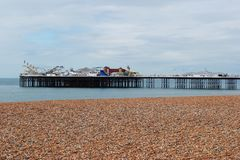 Brighton Pier, view from the beach. British summertime 2015.  Brighton Pier is a holiday destination for thousands of tourists each year. 2015 has been a bit of Royalty Free Stock Images
