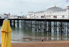 Brighton Pier, view from the beach with swimmer. British summertime 2015.  Brighton beach and Pier is a holiday destination for thousands of tourists each year Royalty Free Stock Photo