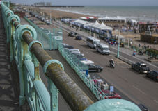 Brighton - the railing. This image shows a beach in Brighton, England with some people walking and chilling Stock Image