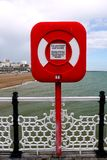 Brighton: red lifesaving ring on pier Royalty Free Stock Image