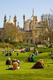 Brighton Royal Pavilion. People relaxing in front of the Royal Pavilion, Brighton, England royalty free stock photo