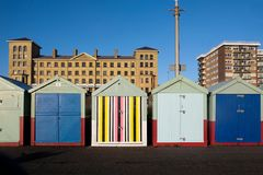 A line of five beach huts on Brighton promenade 5 beach huts are royalty free stock photos