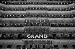 Brighton Sussex UK. Monochrome photograph taken at night of the facade of the newly renovated historic Victorian Grand Hotel. Located on the seafront. Hotel stock photo