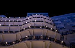 Brighton Sussex UK. Photograph taken at night of the facade of the newly renovated historic Victorian Grand Hotel. Located on the seafront. Hotel was bombed by stock photography