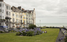 Brighton town - by the sea. This image shows a beach in Brighton, England with some people walking and chilling Stock Photography