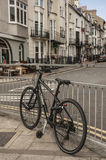 Brighton town - a street with a bike. This image shows a beach in Brighton, England with some people walking and chilling Stock Photos