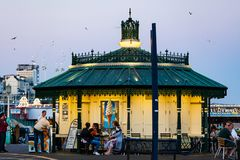 Brighton, UK - June 2018 Snack Eatery House at Brighton Beach in England Seafront. Customers Sitting and Eating Behind stock images