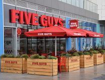 Five Guys restaurant. Brighton, United Kingdom - March 28 2018:   Frontage of Five Guys Restaurant at Brighton Marina Royalty Free Stock Images