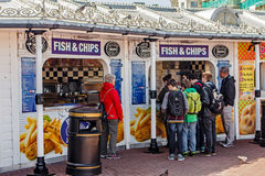 Brighton, United Kingdom. Brighton is one of the biggest and most famous seaside resorts in the UK. People buy fish and chips at a stall next to the Brighton royalty free stock photography