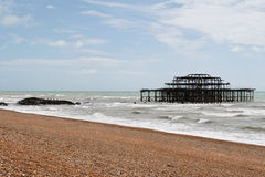 Brighton West Pier and Concert Hall. The remains of the West Pier and the Concert Hall of Brighton after an arson attack in 2003 royalty free stock photography