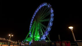 The Brighton Wheel at night, Brighton Beach, East Sussex, England stock video footage