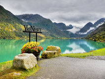 Briksdal, Jostedalsbreen, Oldedalen, Norway. Fascinating green lake and mountains. Oldedalen, Oldevatnet, Yri village. Briksdal, Jostedalsbreen, Norway royalty free stock images