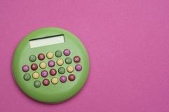 Brigth Calculator on Vibrant Pink Royalty Free Stock Photos