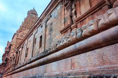 Brihadeeswarar Temple walls with inscriptions in Tamil and Grantha Scripts, Thanjavur. Brihadeeswarar Temple, also referred to as Rajesvara Peruvudaiyar or Royalty Free Stock Photo