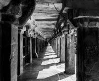 Granite pillars walk way - light and shadow stock images