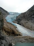 Briksdal glacier. Melting blue ice briksdal glacier  in Norway Royalty Free Stock Images