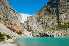 Briksdal glacier in Norway. Briksdal glacier and glacial lake in Jostedalsbreen national reserve, Norway royalty free stock photography