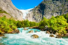 Briksdal glacier and mountain river in Jostedalsbreen national reserve, Norway