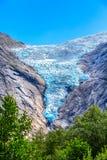 Briksdal glacier, Norway nature landmark. Briksdal or Briksdalsbreen glacier with melting blue ice, Norway nature landmark close-up view royalty free stock photos