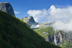 Briksdal Valley. The powerful Briksdal Glacier is a part of the Jostedal Glacier National Park. The wild glacier swoops down from a height of 1200m to the lush royalty free stock photos